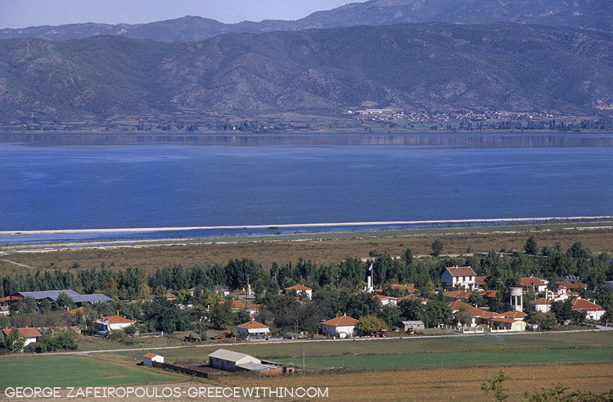 Doiran Lake, the ultimate blue. The village of Doiran ahead and FYROM in the background.