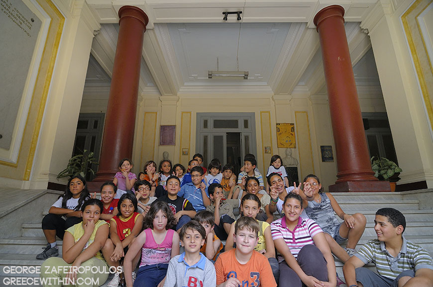 Young students of the primary school at the central entrance.