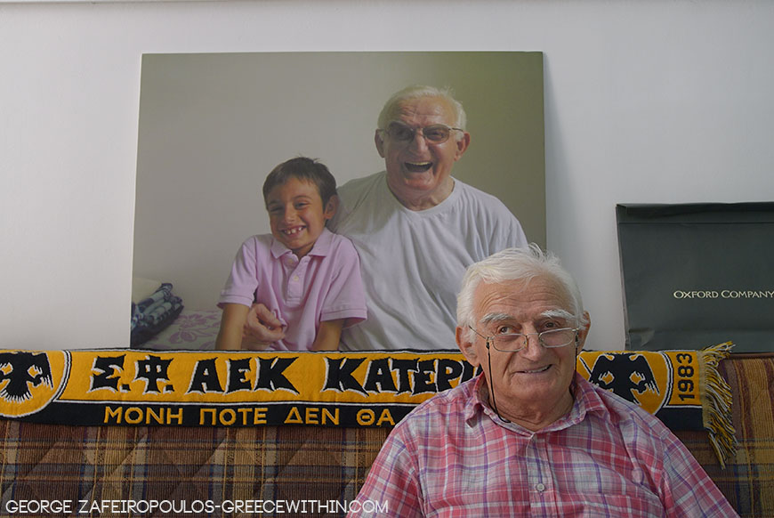 Someone offered him an AEK scarf,  a football team in Katerini, and he sees it as a treasure.