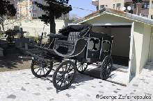 Old hearse trailed by horses in Saint Ignatius of Chalcedon.