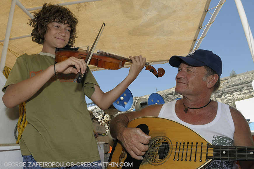 He often plays the lute on his boat and his son Antonis accompanies him with his violin.